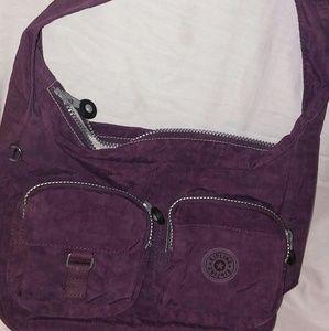 Kipling purple purse in euc. Very clean